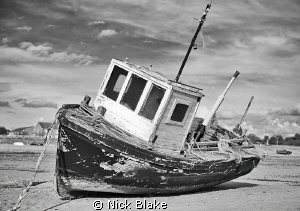 Working boat.....a small fishing boat on the sands at Lyt... by Nick Blake 